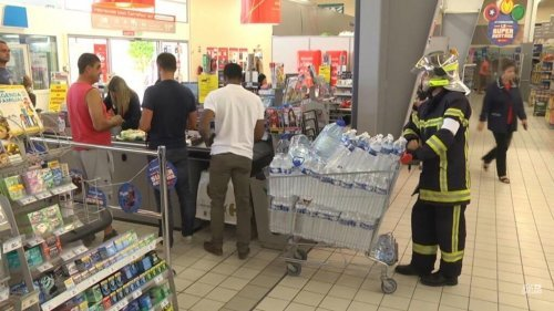 Firefighter buying water